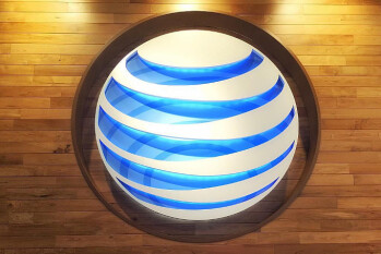 AT&T reports $20 billion tax cuts profit windfall, record low subscriber churn