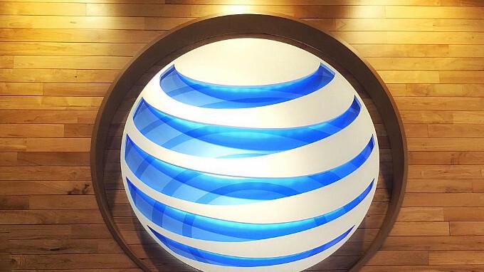 AT&T reports $20 billion tax cuts profit windfall, record low subscriber churn