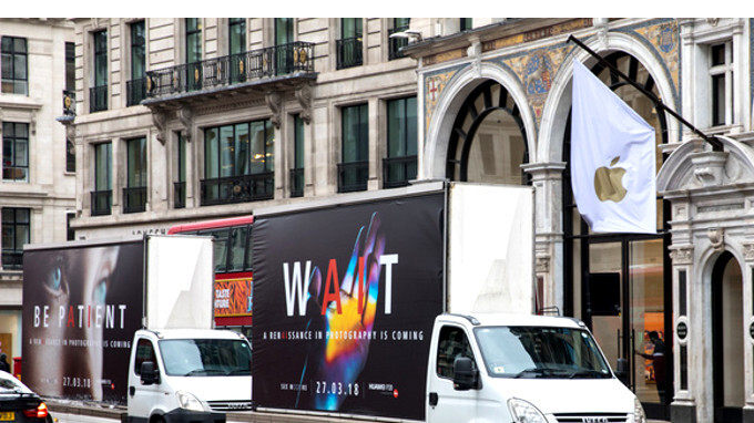 Huawei ad trucks touting the P20 appear before Apple stores in the