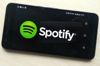 Spotify's shares open at $165.90 valuing the music streamer at $29 billion