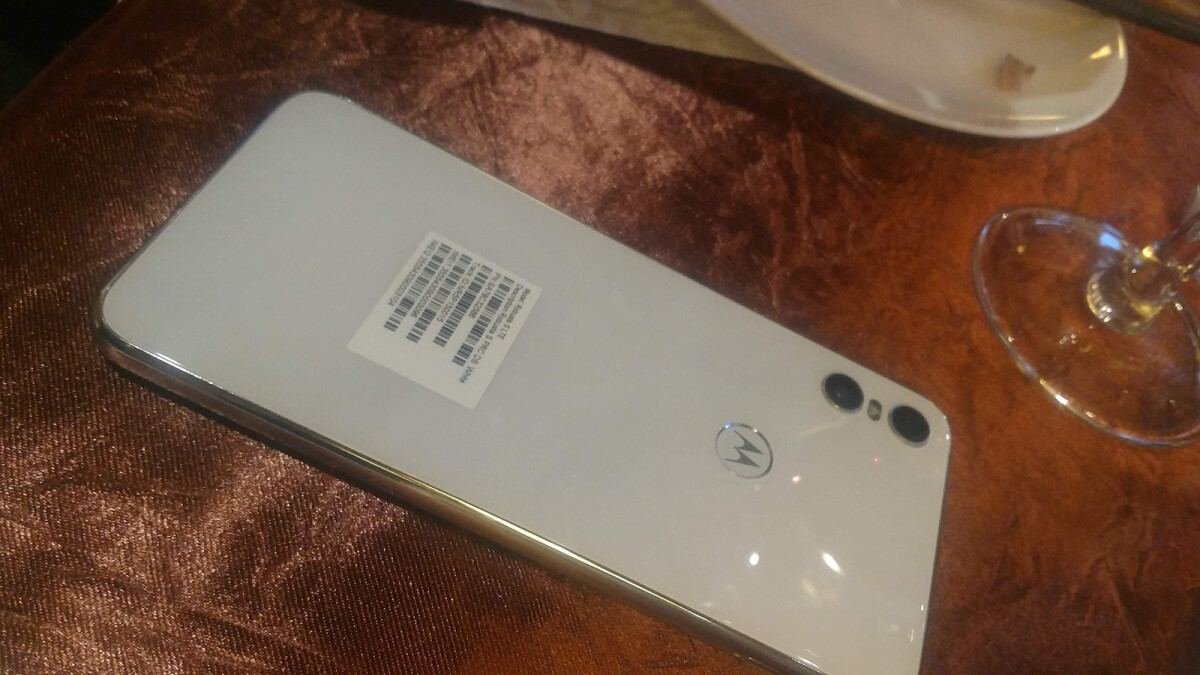 White Motorola One shows its glass rear finish in live images.