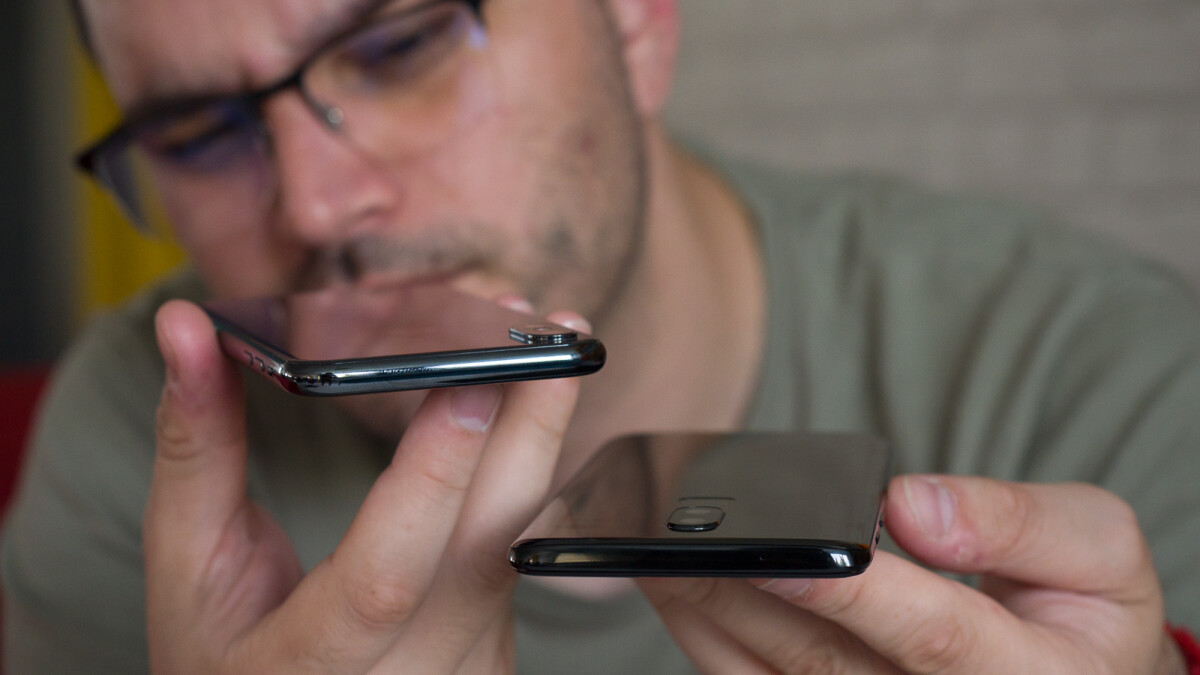 Are reviewers misjudging cheaper smartphones due to their constant exposure to flagships?