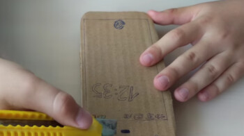 Watch-as-a-young-kid-performs-a-durability-test-on-a-cardboard-Pixel-he-created.jpg