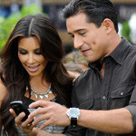 Mario Lopez entertains Kim Kardashian with his BlackBerry Torch