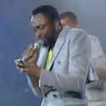 Will. I. Am uses his BlackBerry Torch mid-song to check the lyrics