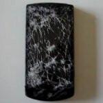 LG Optimus 7 lives through being run over by a car, but it isn't pretty