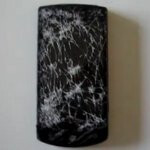 LG Optimus 7 lives through being run over by a car, but it isn't pretty