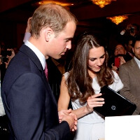 The royal couple gets to play with the HP TouchPad, accepts two as non-profit donation
