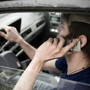 Wise guy loses license after using two cellphones behind the wheel