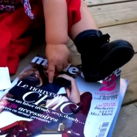 Babies think magazines are tablets that don't work now, the horror of printed media