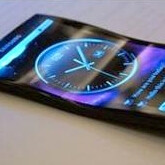 Handheld gadget with flexible display poses for the camera, carries a Samsung logo