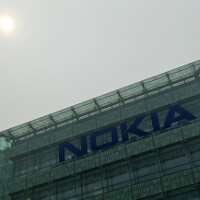 Fitch cuts Nokia credit rating to junk, gives negative outlook
