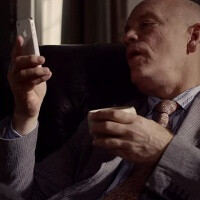 John Malkovich laughs at Siri jokes, asks about the meaning of life in new iPhone ads