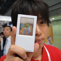 First smartphone with two-sided transparent display gets a prototype, demonstrated in Japan