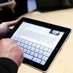 By 2014, your office will have more Apple iPad users than those totin' a BlackBerry smartphone