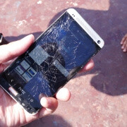 HTC One vs iPhone 5 drop test results in broken glass, shattered dreams