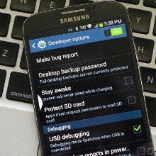 How to unlock developer settings on the Galaxy S4: tap seven times on the build number