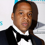 Jay-Z drops his Apple iPhone for what we assume is a Samsung Galaxy S4