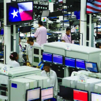 Texas Govenor Perry tosses away an Apple iPhone at Motorola Moto X facility