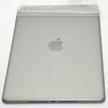New space gray Apple iPad 5 tablet pictured from all angles, stacked with the silver one