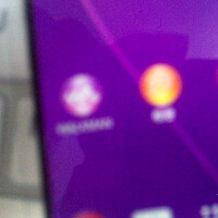 Blurry images of a thin-bezel Xperia appear, along with battery life screenshots from Sony Sirius