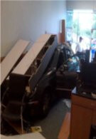 Woman plows her car into a store for a Pre