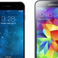 A 4.7 inch Apple iPhone 6 is compared size-wise with a current batch of heavyweight Android models