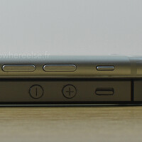 Apple iPhone 6 dummy poses for size comparison with the Apple iPhone 5s