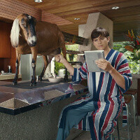 Ashton Kutcher is milking a goat in the first video ads for Lenovo's new tablets