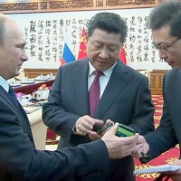 Vladimir Putin presents the People's President with the pinnacle of Russian tech, YotaPhone 2