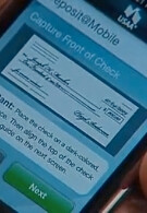 USAA allows you to deposit checks using iPhone's camera and app