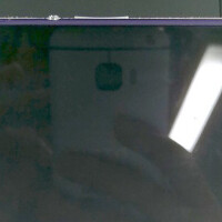 Reflection on another phone reveals the back of the HTC One (M9)?