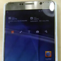 Samsung Galaxy Note 5 appears in gold; your index finger will be used to pry out the S Pen