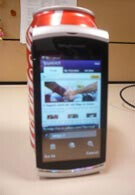 Pictures of the Sony Ericsson Kurara and a Coca-Cola can
