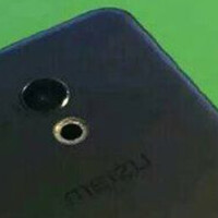 Meizu Pro 6 smiles for photo wearing black metallic case, carrying deca-core CPU and 4GB of RAM