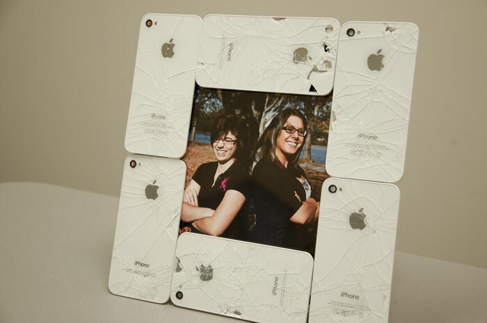 Broken iPhones turned into useful artwork
