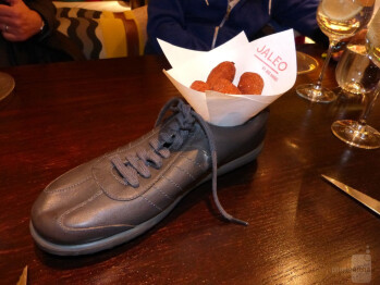 Yes, that is food being served in a shoe, a trademark of the Jaleo restaurant