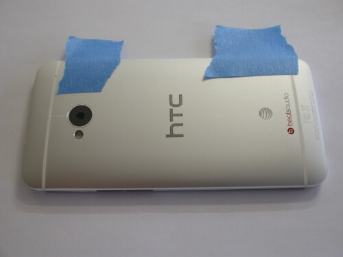 Clean the display and apply two strips of masking tape at the back of the phone