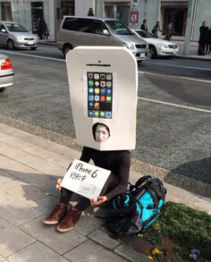 First in line for the Apple iPhone 6 is performance artist Yoppy