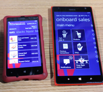 The Nokia Lumia 820 (L) and the Nokia Lumia 1520 shown running Delta's custom in-flight retail sales app