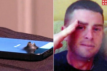 Staff Sgt. Shaun Frank (R) has his life saved by his Apple iPhone 5s
