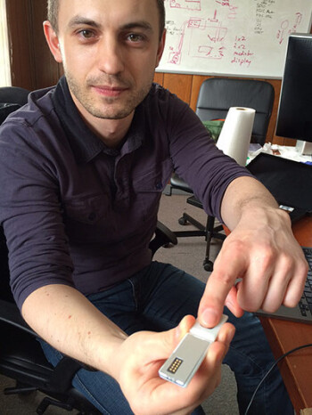 Paul Eremenko, a project leader, demonstrates a prototype pulse meter module.