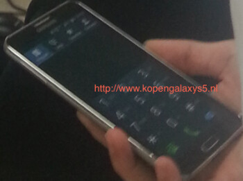 Is this the Samsung KQ? Close-up of screen (R) shows it extending to the edge, something not seen on the Samsung Galaxy S5
