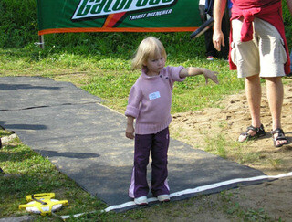 A phone throwing athlete in Junior category - Did you know: the Mobile Phone Throwing World Championships is an annual event; world record stands at over 300 feet