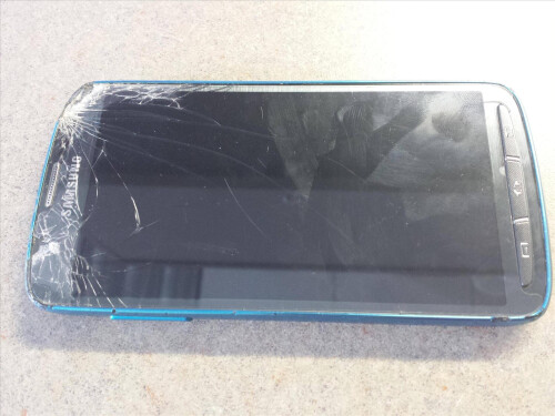 Galaxy S4 Active gets sliced and diced by a lawnmower, stays active