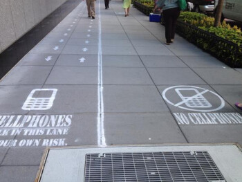 Sidewalk in Washington D.C. is marked up for a television show