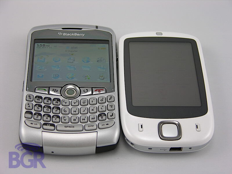 HTC Elf next to BlackBerry Curve and T-Mobile Wing (HTC Herald) - HTC Elf is snow-white