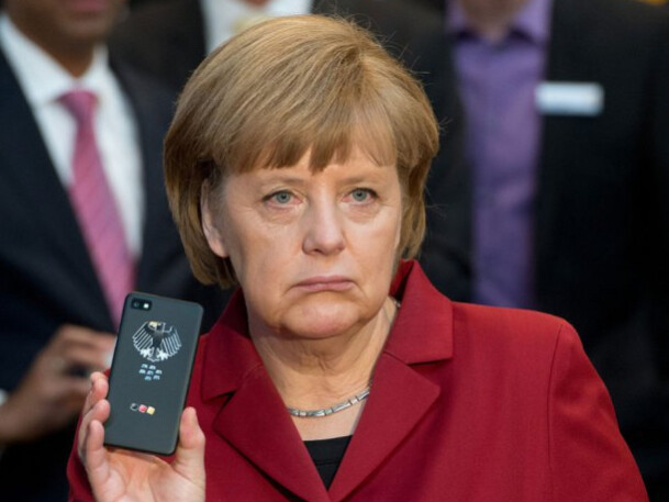 German Chancellor Angela Merkel holds up her secure BlackBerry handset - Germany looking to buy 20,000 BlackBerry 10 phones for its officials?