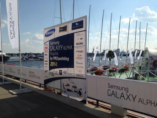 Samsung Galaxy Alpha signage appears at a sponsored regatta in Moscow