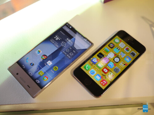 Sharp AQUOS Crystal versus Apple iPhone 5s first look